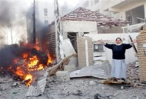 iraqi woman in front of her house that was bombed in baghdad, january 25 2010