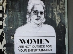 "[Image: drawing of a woman with the words ""Women are not outside for your entertainment.""]"